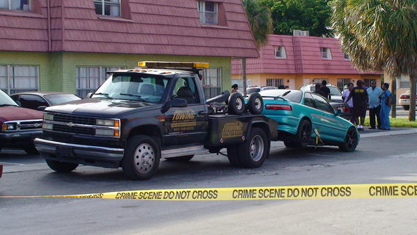 Shots were fired to scare a tow truck driver as she prepared to haul away a car in Lauderhill on Aug. 14, 2013.