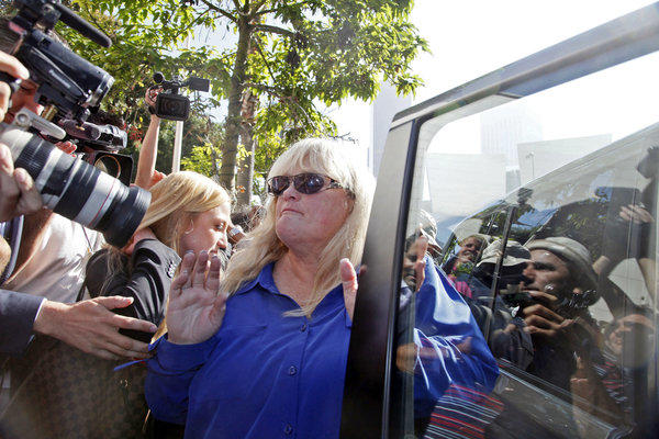 Debbie Rowe, Michael Jackson's ex-wife and mother of two of his children, leaves Los Angeles County Superior Court after testifying Wednesday in the wrongful death suit filed against AEG Live.