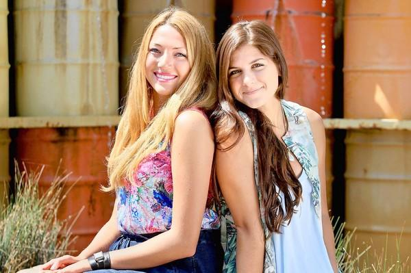 Corona del Mar High seniors Amanda Penna, left, and Courtney Garkani, both 17, about a year ago co-founded CREST Independent, an online surf and style magazine that focuses on beach culture, music, fashion and art. Seen here, the two pose for a portrait at The Lab Anti-Mall in Costa Mesa on Wednesday. CREST is an acronym for the site's five main sections, Culture, Resource, Entertainment, Style and Tell. The magazine's one-year anniversary is on September 9, 2013.