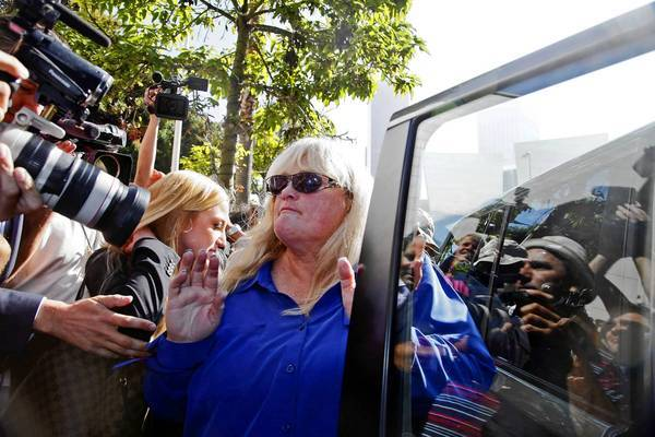 Debbie Rowe, Michael Jackson's former wife and mother of two of his children, leaves Los Angeles County Superior Court after testifying Wednesday.