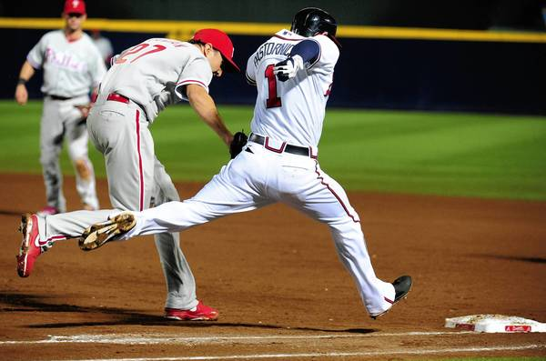 Atlanta's Tyler Pastornicky outruns the Phillies' John Lannan to first base for an infield hit Wednesday night.