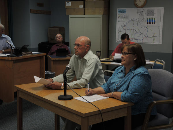 Butch Frye and Shirley Gillespie, director of the Charlevoix County Commission on Aging, speak to the Charlevoix County Board of Commissioners about buying property for a senior center in East Jordan.