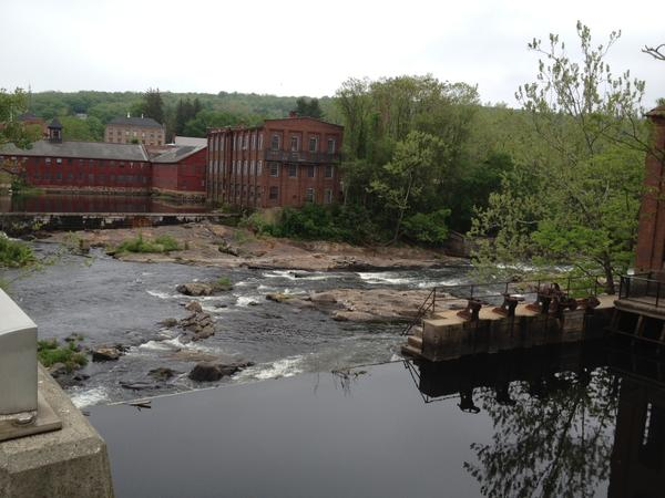 A view of the former Collins Company factory and the dam that once generated electricity for it. Officials in Canton are trying to use the dam for hydropower once again.