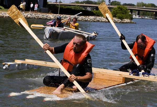 Daily Press file photo Chris Frazier and Todd Van Guilder competed in and won the 2008 Freaky Kon-Tiki Raft Race with a boat made of PVC pipes, plastic 2-liter bottles and wood. This year's event will be held Saturday.