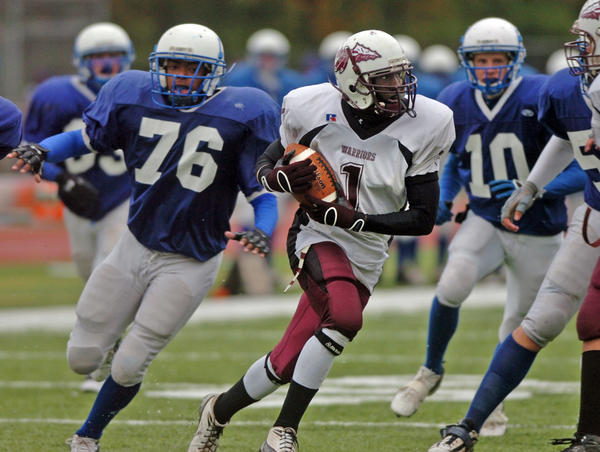 Windsor's Justin Wilson runs past Hall defenders on his way to score in the 3rd quarter of their game at Hall High School in 2007.