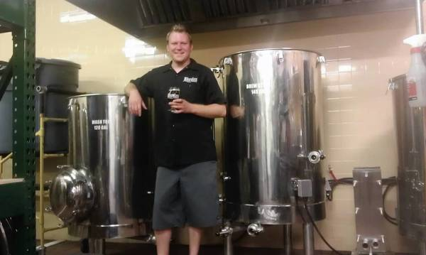 Brew master Sky Conley toasts a year of beer at Hourglass Brewing.