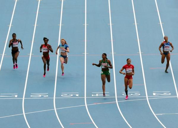 Allyson Felix leads the pack in the 200-meters semifinal race.