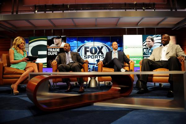 Charissa Thompson, Donovan McNabb, Gabe Kapler and Ephraim Salaam talk during rehearsals for Fox Sports 1 in Los Angeles.