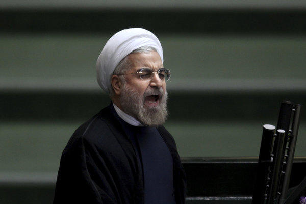 In Tehran, Iranian President Hassan Rouhani speaks during the parliamentary debate on his proposed Cabinet members.