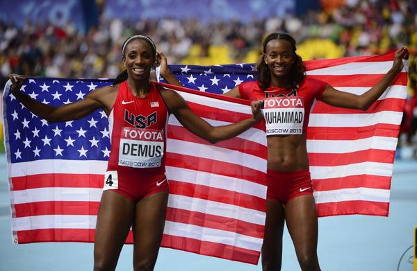 U.S. teammates Dalilah Muhammad, right, and Lashinda Demus celebrate after taking silver and bronze, respectively, in the women's 400-meter hurdles at the world championships Thursday in Moscow.