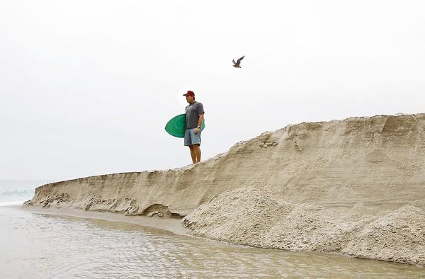 Tex Haines is concerned about the sand county workers shovel from Aliso Beach Park into the ocean. He claims the current takes the sand south where it settles at other South Laguna beaches.