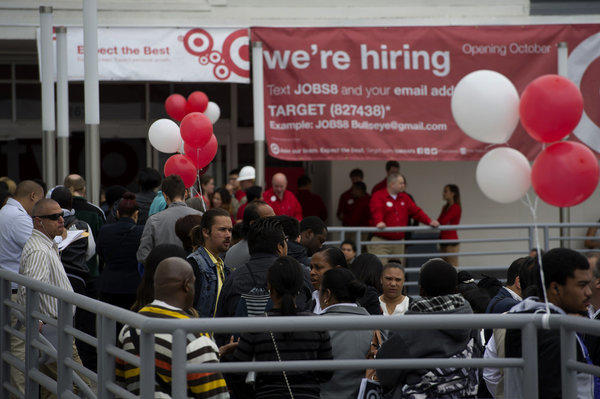 Economists expect to see modest growth in California jobs for the month of July. Above, Target hosts a job fair.