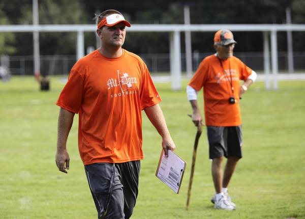Coaches Chad Grabowski, left and Bill Peck during practice at Mount Dora High School. High schools throughout Central Florida, including the Mount Dora Hurricanes had their firs football practice on August 5, 2013.