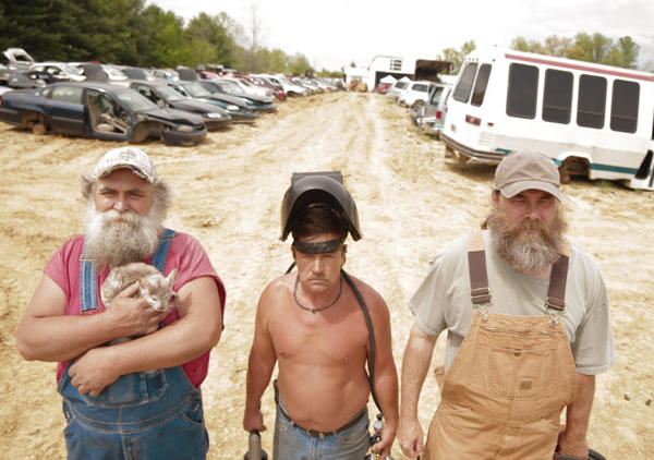 """Dirty"" Andy Minnick (left), Terry Porter and Jeff Watson star in the new AMC reality series ""Porter Ridge."""