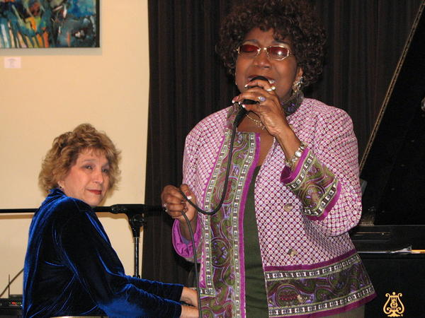 Jacqueline Jones sings, while Carol Stein accompanies on the piano.