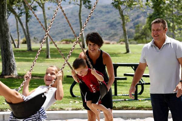 Scott and Danielle Nelson play at an Aliso Viejo park with their two children, Taylor, 7, and Dane, 3. Danielle, 42, was diagnosed with cancer in March.