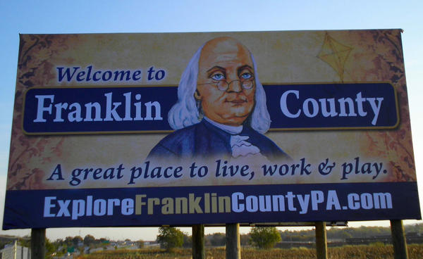 A billboard along Interstate 81 welcomes visitors to Franklin County, Pa., and includes the website for the Franklin County Visitors Bureau.