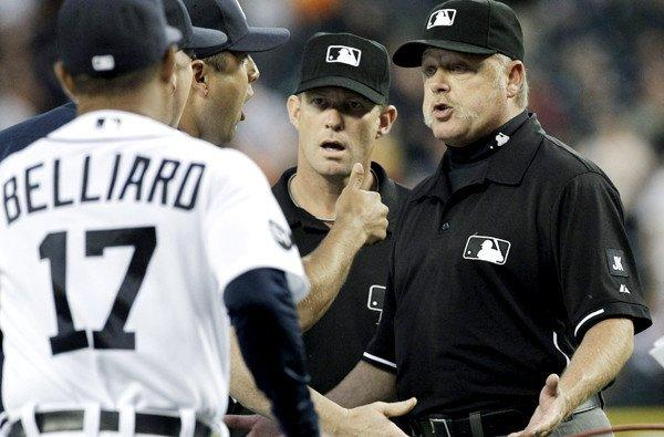 Umpires Jim Wolf (center) and Jim Joyce listen to an appeal by Detroit's Gerald Laird and Rafael Belliard after Joyce's incorrect call at first base cost pitcher Armando Galarraga a perfect game.