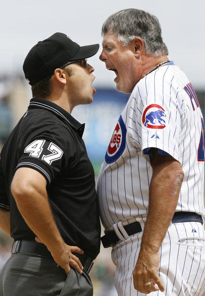 Then-Chicago Cubs Manager Lou Piniella argues with umpire Mark Wegner in 2007. Piniella was ejected by Wegner.
