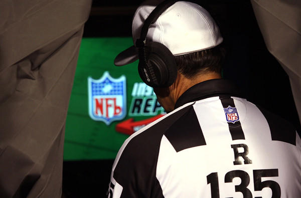 NFL referee Pete Morelli reviews a play during a preseason game between the Dolphins and Chiefs.