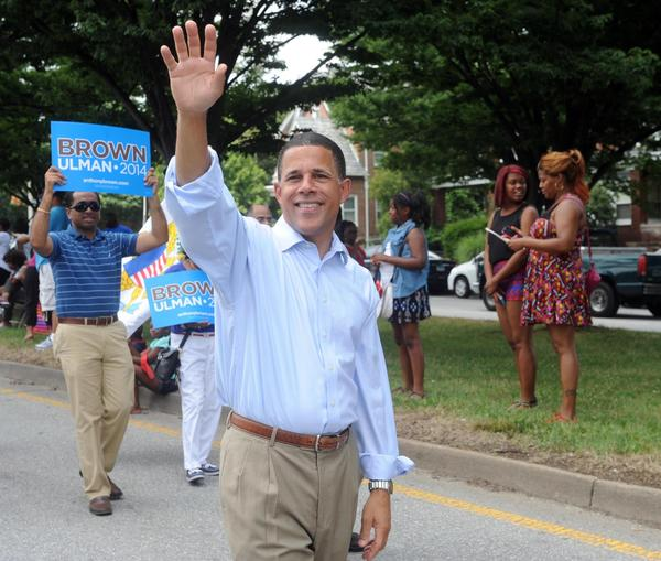 Lieutenant Governor Anthony Brown, the grand marshal of the annual Baltimore/Washington One Caribbean Carnival, waves to spectators on E 33rd Street.