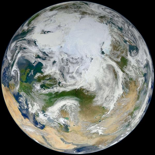 The Earth is seen from over the Arctic as captured by the Suomi National Polar-orbiting Partnership (S-NPP) satellite. The disappearing Arctic sea ice has set off a dangerous feedback loop -- warming that feeds on itself -- as dark heat-absorbing water replaces the white ice that used to reflect heat back to space.
