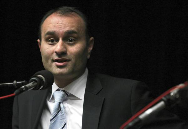 Amer Ahmad, former comptroller of the city of Chicago, was indicted Thursday on charges of money laundering, conspiracy, honest services wire fraud, conspiracy to commit money laundering, federal program bribery and making false statements.