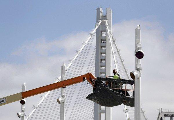 This photo taken Aug. 1, 2013, shows a worker on the troubled eastern span of the San Francisco-Oakland Bay Bridge in San Francisco. Officials are pressing ahead to open the span to traffic around Labor Day weekend.