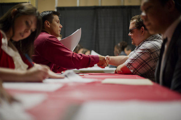 Despite July's increase in the unemployment rate, California has outpaced the U.S. in job creation over the past year. Here, job-seekers attend a job fair at a new Target store in San Francisco.