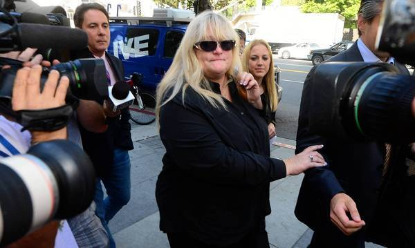 Michael Jackson's former wife, Debbie Rowe, arrives at court in Los Angeles to testify in the trial of the wrongful-death lawsuit filed by the late singer's mother and three children against concert promoter AEG Live.