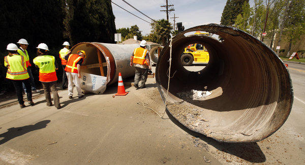 Los Angeles Department of Water and Power officials survey construction along Coldwater Canyon Blvd. in Studio City.