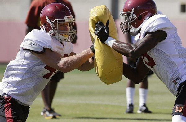 USC receivers Robby Kolanz, left, and Nelson Agholor participate in a training drill during a practice earlier this month.