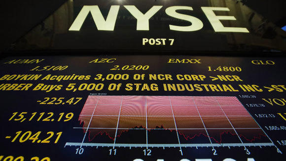 A screen showing the day's final numbers is displayed above the floor of the New York Stock Exchange Thursday.