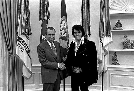 Elvis Presley shakes hands with President Richard Nixon. ( AFP /August