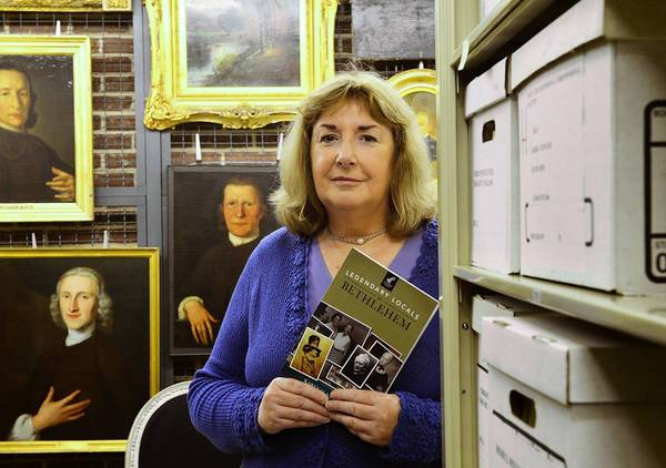 Karen Samuels stands in the Moravian Archives in Behtlehem, where she did much of her research for her new book 'Legendary Locals of Bethlehem.'