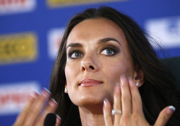 Russian pole vaulter Yelena Isinbayeva drew criticism for her comments about protests against Russia's anti-gay law at the World Athletics Championships in Moscow.