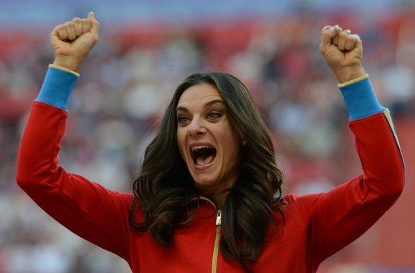 Russia's Yelena Isinbayeva smiles on the podium during the medal ceremony for the women's pole vault at the 2013 IAAF World Championships in Moscow on Thursday.