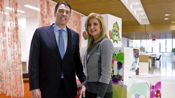 AOL CEO Tim Armstrong with Ariana Huffington at AOL headquarters in 2011.