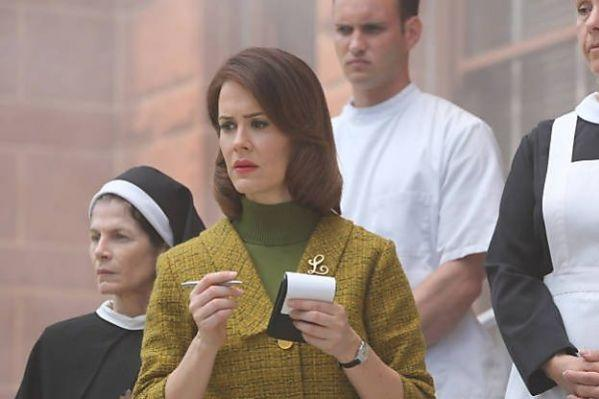"""Sarah Paulson, center, as a reporter-turned-mental patient Lana Winters in FX's """"American Horror Story: Asylum"""""""