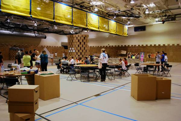Volunteers work on creating the world's largest cardboard castle at Neuqua Valley High School.