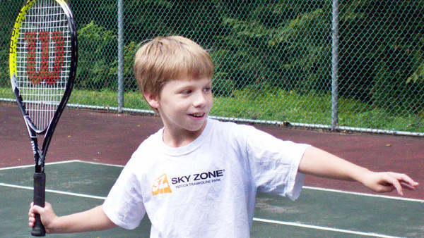 Carter Curry takes a swing at tennis. HT - Judy Wagley