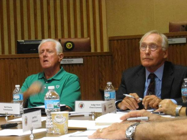 Tinley Park Term Limits Commissioner Neil Finerty and Chairman Kent Slater speak during the panel's Aug. 14 meeting, where each member presented a recommendation on the issue.