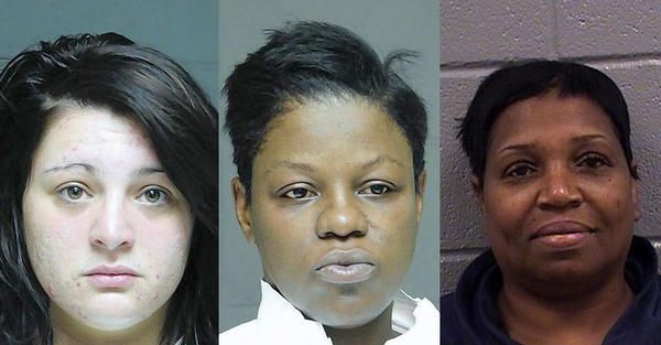 Tracy Musiala (left) and Angel R. Wingard (right) have been charged with one felony count each of having a continuing financial crimes enterprise. Star. L. Davis (center) has been charged with a felony count of being an organizer of a continuing financial crimes enterprise and multiple misdemeanors of theft and theft by deception.