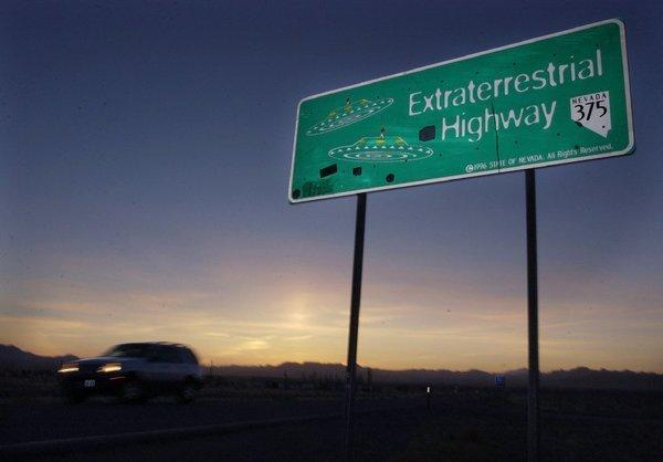 A car moves along the Extraterrestrial Highway near Rachel, Nev., and Area 51.