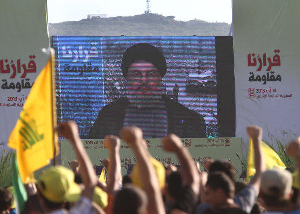 Hezbollah supporters watch a televised address by their leader, Hassan Nasrallah, at a rally in south Lebanon, near the Israeli border.
