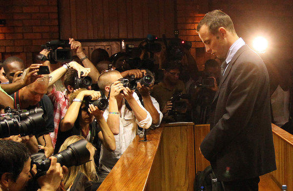South African Olympic sprinter Oscar Pistorius stands in the dock during a bail hearing at the Pretoria Magistrate's Court in February.
