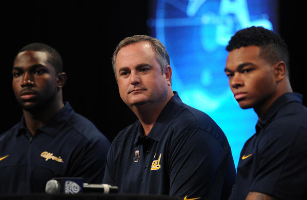 California coach Sonny Dykes (center) with linebacker Nick Forbes (left) and wide receiver Bryce Treggs during PAC-12 media day in July.