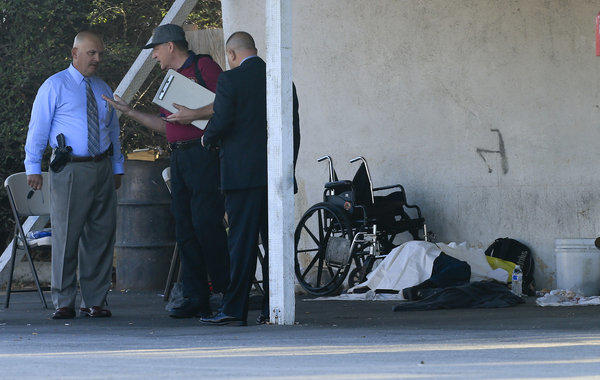 Los Angeles County sheriff's detectives investigate the killing of two men in Glendora. One victim was found under an awning behind a car wash, and the other was found on a sidewalk a short distance away.