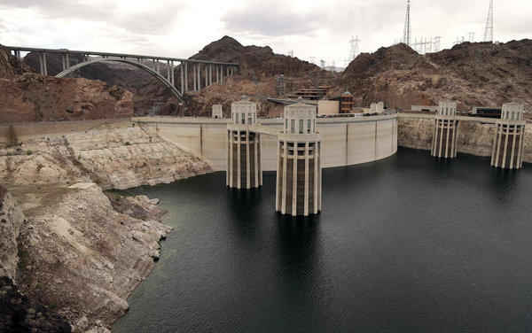 The high water mark for Lake Mead is seen on Hoover Dam and its spillway near Boulder City, Nev. After back-to-back driest years in a century on the Colorado River, federal water managers are announcing a historic step to slow the flow of water from a massive reservoir upstream of the Grand Canyon to the huge Lake Mead reservoir behind Hoover Dam near Las Vegas.