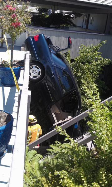 A Laguna Beach woman was not injured when the car she was in rolled through a barrier and crashed into the first floor of an apartment building at 235 Lower Cliff Dr., late Friday morning. She allegedly hit the gas pedal instead of the brakes, according to police.